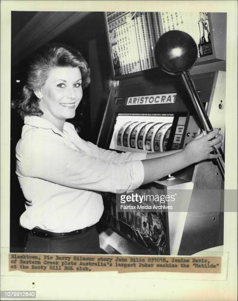 Janine Davis of Eastern Creek plats Australia's largest Poker machine the Matilda at the Rooty Hill RSL club October 18 1988