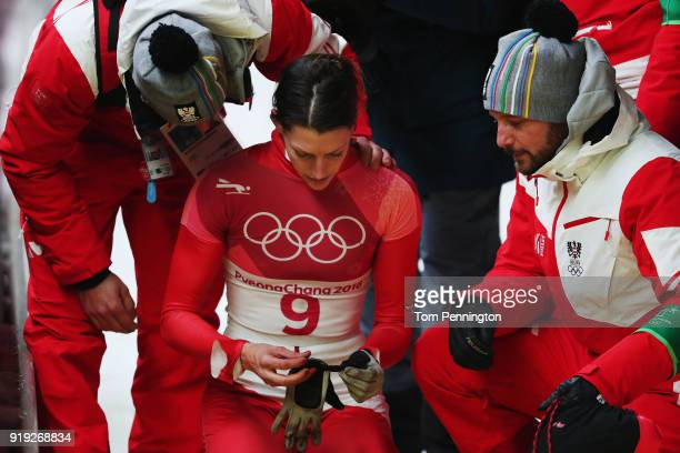 Janine Flock of Austria is consoled after her final run during the Women's Skeleton on day eight of the PyeongChang 2018 Winter Olympic Games at...
