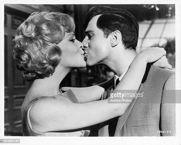 Janine Gray kisses George Maharis in a scene from the film 'Quick Before It Melts' 1964