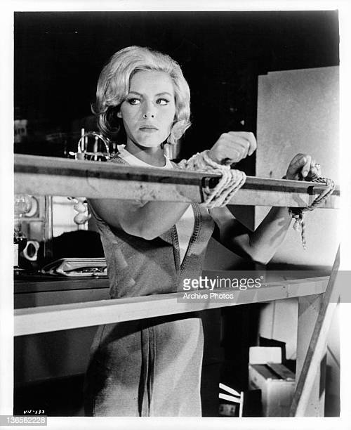 Janine Gray tied to rail in a scene from The Deadly Games Affair episode from the television series 'The Man From UNCLE' 1964