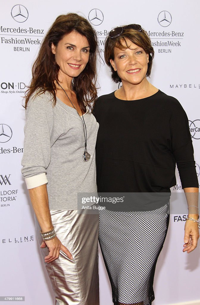 Janine Hartwig (R) and guest attend the Minx by Eva Lutz show during the Mercedes-Benz Fashion Week Berlin Spring/Summer 2016 at Brandenburg Gate on July 8, 2015 in Berlin, Germany.