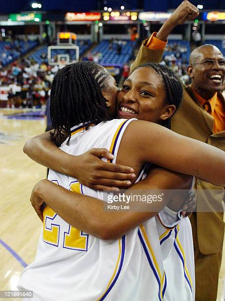 Janine Jackson and Alexis GrayLawson of Oakland Tech embrace during the CIF State Division I Girls Basketball final against Canyon Springs at the...