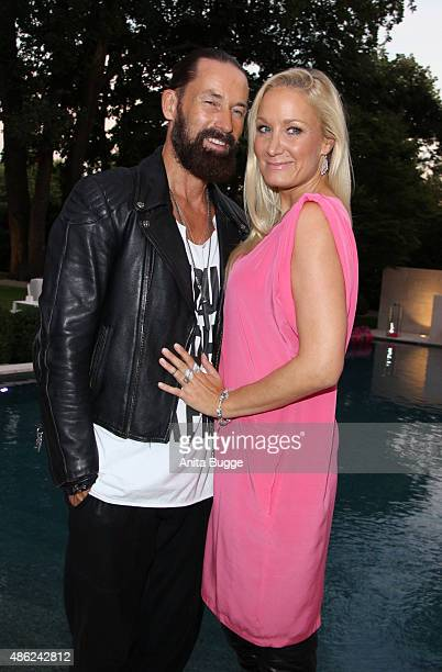 Janine Kunze and her husband Dirk Budach attend the JT Tourism BBQ Party at 'Pink Villa' on September 2 2015 in Berlin Germany