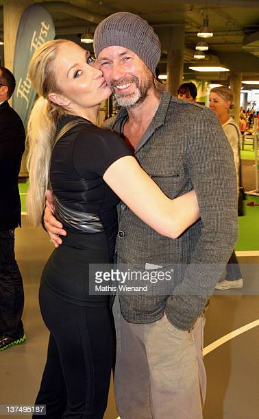 Janine Kunze and her husband Dirk Budach attends the Opening at Fitness First Platinum Club MyZeil on January 21 2012 in Frankfurt Germany