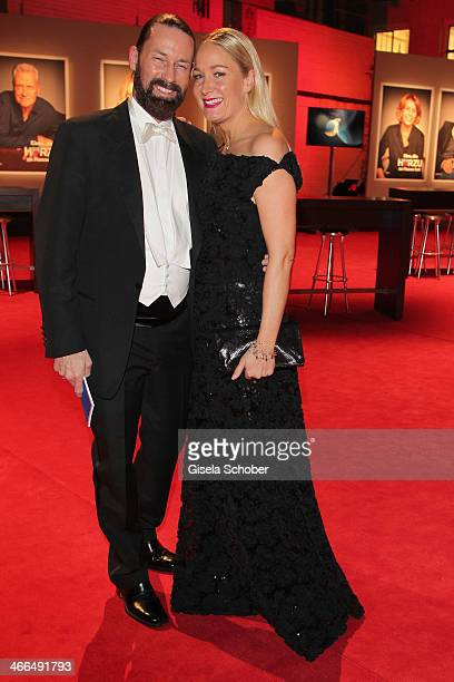 Janine Kunze and husband Dirk Budach attend the Goldene Kamera 2014 at Tempelhof Airport Hangar 7 on February 1 2014 in Berlin Germany