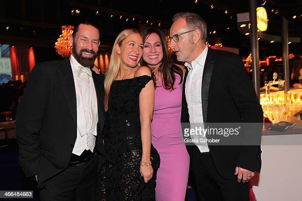 Janine Kunze and husband Dirk Budach Reinhold Beckmann and wife Kerstin attend the after show party of Goldene Kamera 2014 Hangar 7 at Tempelhof...