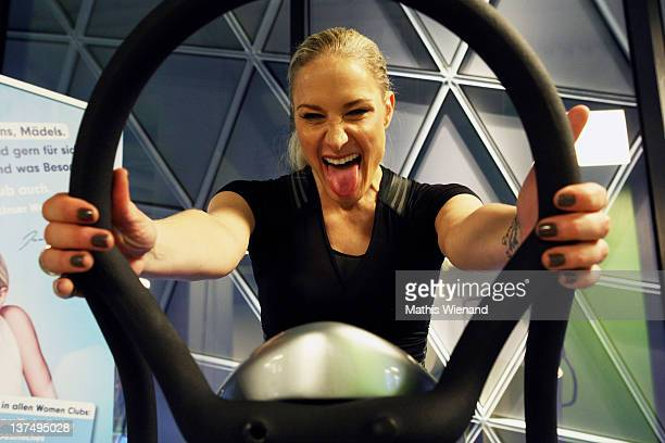 Janine Kunze pose on the fitness equipment at the Opening at Fitness First Platinum Club MyZeil on January 21 2012 in Frankfurt Germany