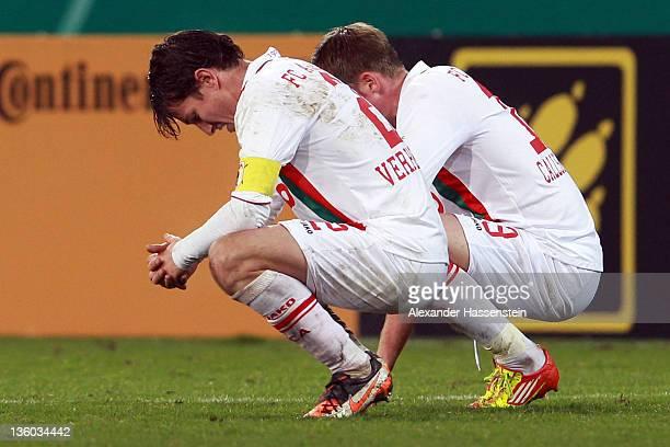 Jan-Ingwer Callsen-Bracker of Augsburg and his team mate Paul Verhaegh reacts after the DFB Cup round of sixteen match between TSV 1899 Hoffenheim...