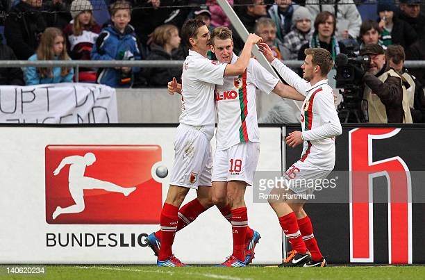 JanIngwer CallsenBracker of Augsburg celebrates his teams second goal with teammates during the Bundesliga match between Hannover 96 and FC Augsburg...