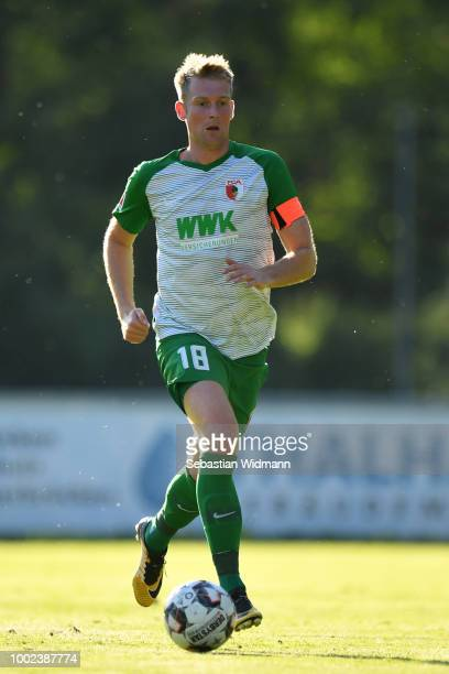 JanIngwer CallsenBracker of Augsburg plays the ball during the preseason friendly match between SC Olching and FC Augsburg on July 19 2018 in Olching...