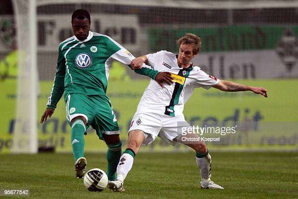 JanIngwer CallsenBracker of Moenchengladbach tackles Grafite of Wolfsburg during the Wintercup match between Borussia Moenchengladbach and VfL...