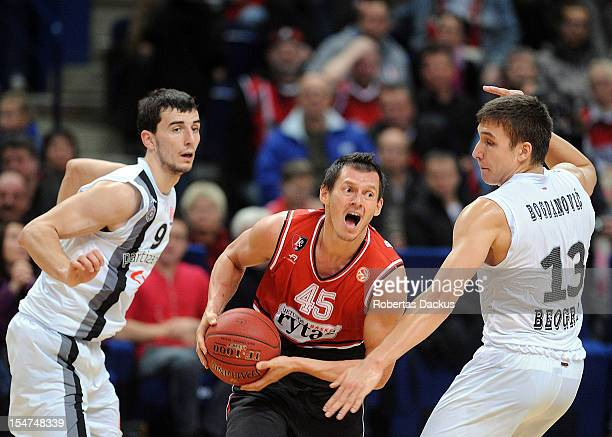 Janis Blums #45 of Lietuvos Rytas Vilnius competes with Bogdan Bogdanovic #13 of Partizan mts Belgrade during the 20122013 Turkish Airlines...