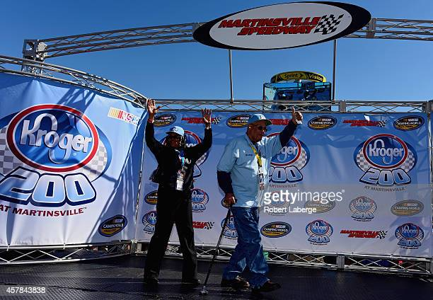 Janis Davis and Wendell Scott are introduced during pre-race ceremonies for the NASCAR Camping World Truck Series Kroger 200 at Martinsville Speedway...