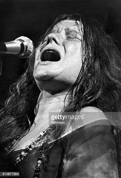 Janis Joplin American rock singer and electrifying performer Head and shoulders photograph during a performance ca 1969