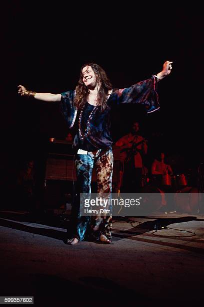 Janis Joplin stands with arms outstretched during her performance at the Woodstock Music and Art Fair | Location Near Bethel New York USA