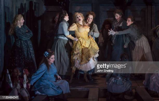 Janis Kelly as Polly Nichols with the Company performs on stage in a production of Iain Bell's Jack The Ripper by the English National Opera at...