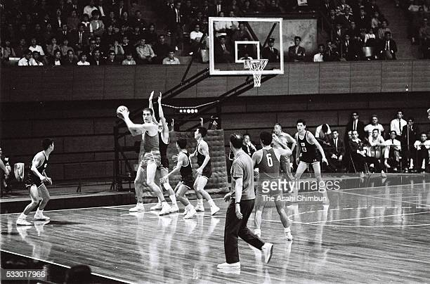 Janis Krumins of Soviet Union keeps the ball in the Basketball Group A match between Japan and Hungary at the Yoyogi National Gymnasium during the...