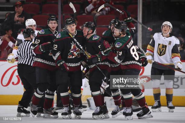 Janis Moser, Vladislav Kolyachonok, Reece Vitelli and Anri Ravinskis of the Arizona Coyotes celebrate after Kolyachonok scored a goal against the...