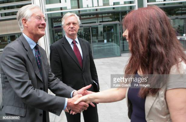 Janis Sharp mother of Gary McKinnon shakes hands with Former Labour minister Michael Meacher after he met the Home Secretary Alan Johnson and urged...