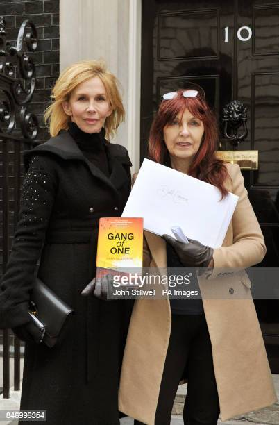 Janis Sharp the mother of Gary McKinnon with Trudie Styler as they stand outside number 10 Downing Street before handing in a book and poems written...
