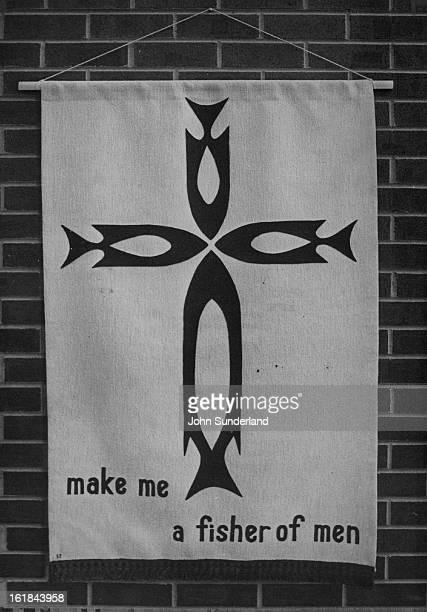 JUL 8 1975 JUL 10 1975 JUL 11 1975 Janis Shubert incorporates stylized fish designs in the form of a crucifix in her cloth collage banner in blue and...