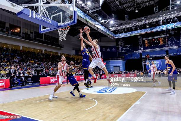 Janis Strelnieks #13 of Olympiacos Piraeus in action against Anthony Gill of Khimki Moscow in the Turkish Airlines Euroleague Opening round of the...