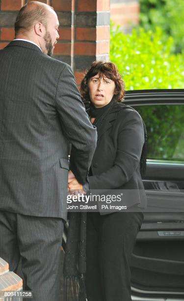 Janis the mother of singer Amy Winehouse arrives at Golders Green Crematorium in north London for her daughter's private funeral service