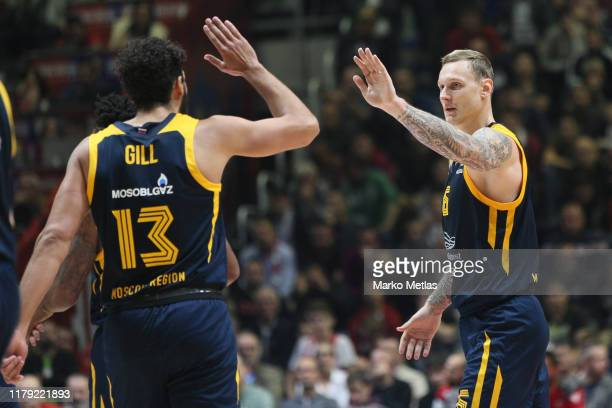 Janis Timma #6 of Khimki Moscow Region and Anthony Gill #13 of Khimki Moscow Region celebrate during the 2019/2020 Turkish Airlines EuroLeague...
