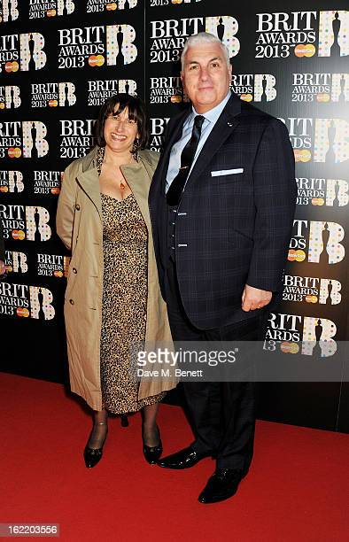 Janis Winehouse and Mitch Winehouse arrive at the BRIT Awards 2013 at the O2 Arena on February 20 2013 in London England