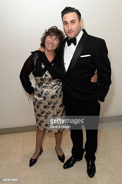 Janis Winehouse with her son Alex attend the Amy Winehouse Foundation Ball at the Dorchester Hotel on November 20 2013 in London England