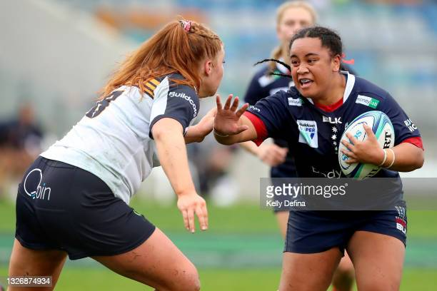 Janita Kareta of the Rebels runs with the ball under defensive pressure from Grace Kemp of the Brumbies during the Super W match between the...