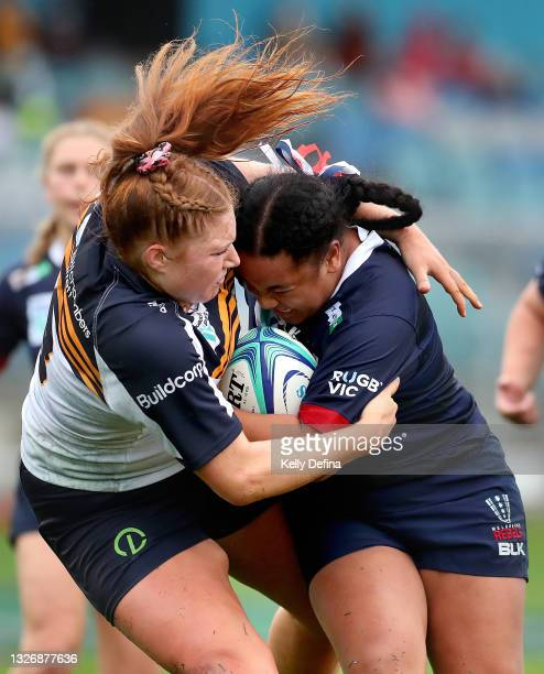 Janita Kareta of the Rebels runs with the ball while being tackled Grace Kemp of the Brumbies during the Super W match between the Melbourne Rebels...