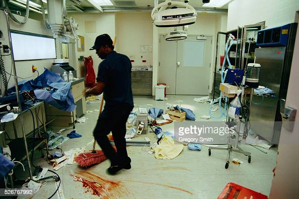 A Janitor Cleans An Emergency Room Pictures Getty Images