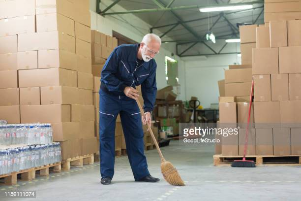 janitor cleaning a warehouse - sweeping stock pictures, royalty-free photos & images