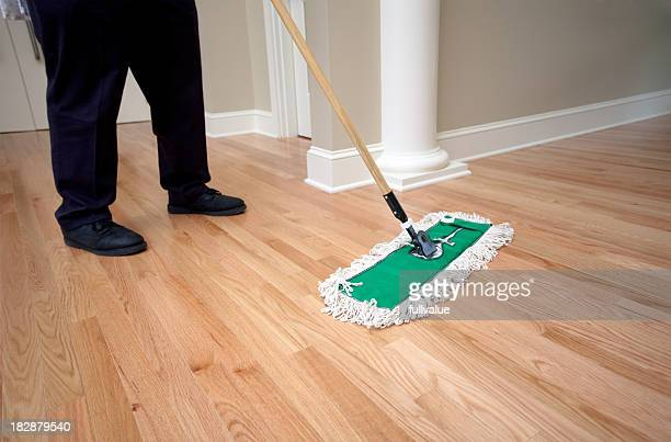 Janitor Dusting Hardwood Floor