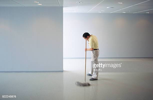 Janitor Mopping Floors at Harumi Pier