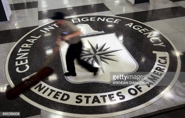 A janitor mops the floor at the headquarters of the Central Intelligence Agency 03 March 2005 in Langley Virginia AFP PHOTO/ Brendan SMIALOWSKI / AFP...