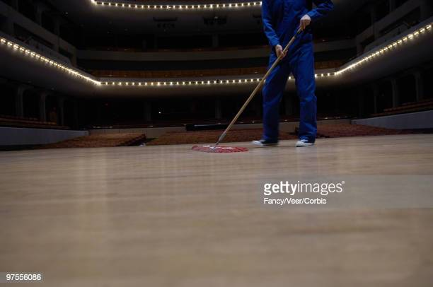 janitor sweeping stage - sweeping stock pictures, royalty-free photos & images