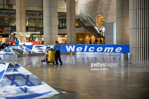 Janitor walks through an empty arrivals gate at terminal three of Ben Gurion Airport on July 24, 2014 in Tel Aviv, Israel. The Federal Aviation...