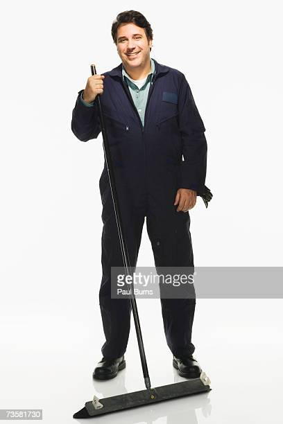 Janitor with broom on white background, portrait