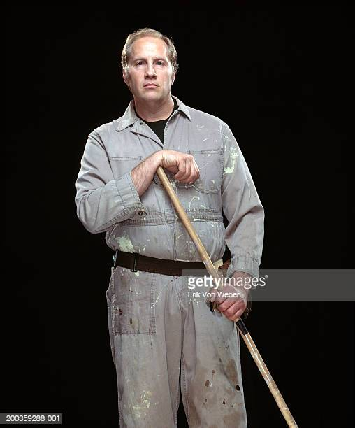 Janitor with mop, portrait