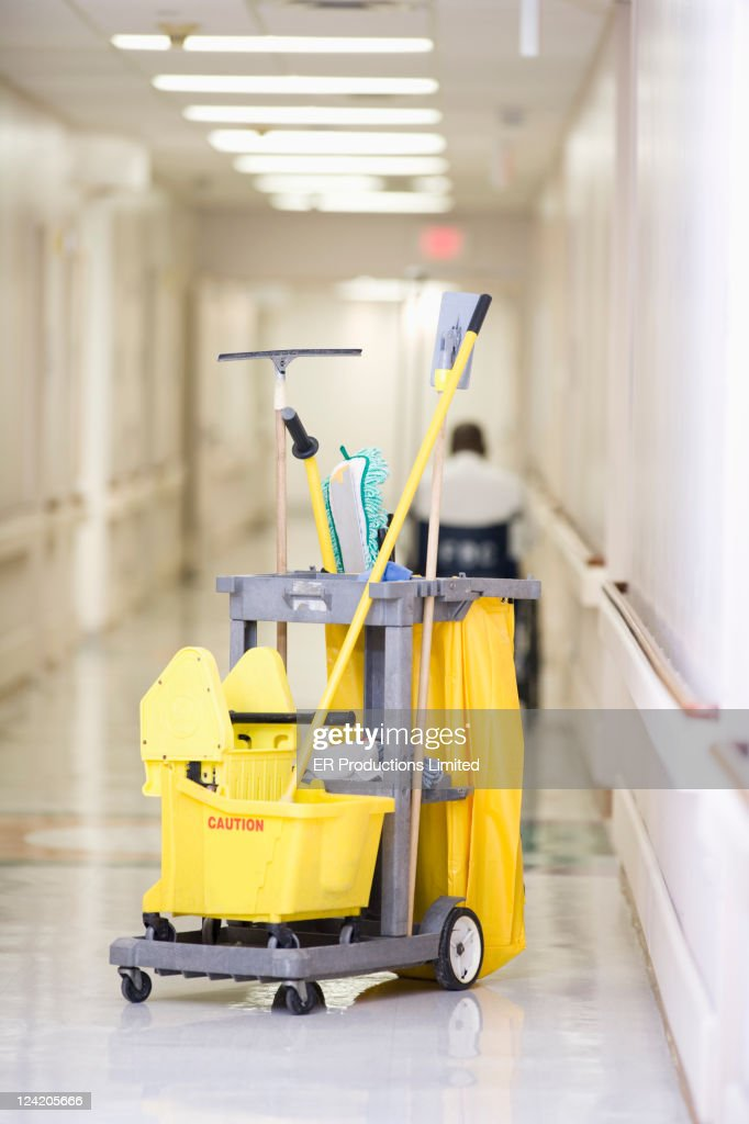 Janitorial cleaning cart in hospital corridor : Stock Photo