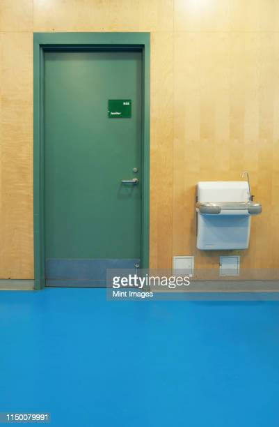 janitorial closet and drinking fountain - janitorial supplies stock photos and pictures