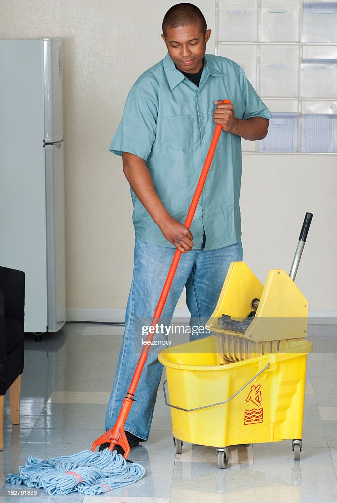Janitorial Services - Maintenance Man Cleaning Office Floor : Stock Photo