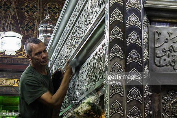 Janitorial workers at AlHussein Mosque cleans up the tomb of Imam Hussein in preparation for the big night Cairo
