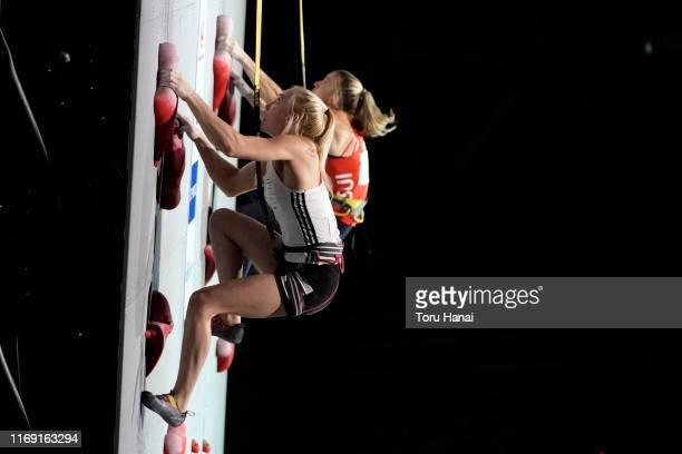 Janja Garnbret of Slovenia and Petra Klingler of Switzerland compete in the Speed during Combined Women's Final on day ten of the IFSC Climbing World...