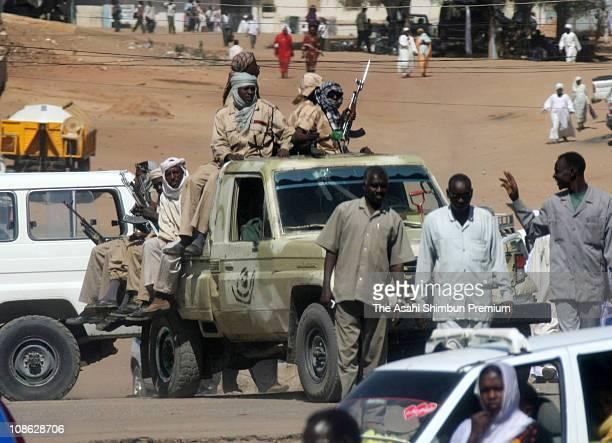 Janjaweed militia of Arabic tribe are seen on a armed truck on December 10 2007 in Al Fashir Darfur Sudan