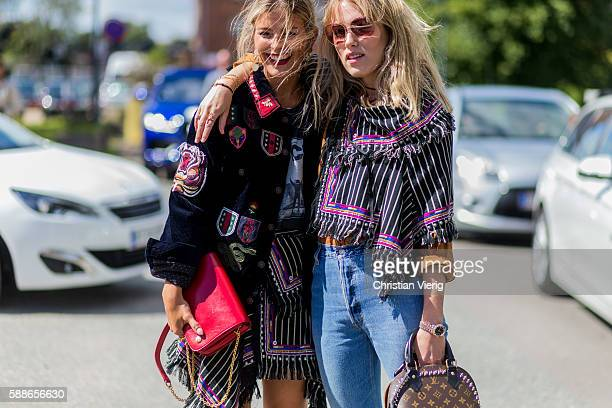 Janka Polliani and Annabel Rosendahl wearing Isabel Marant scarf outside By Malene Birger during the second day of the Copenhagen Fashion Week...