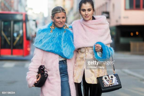 Janka Polliani Darja Barannik wearing pink coat fake fur scarf Loewe bag Louis Vuitton bag on February 7 2017 in Oslo Norway