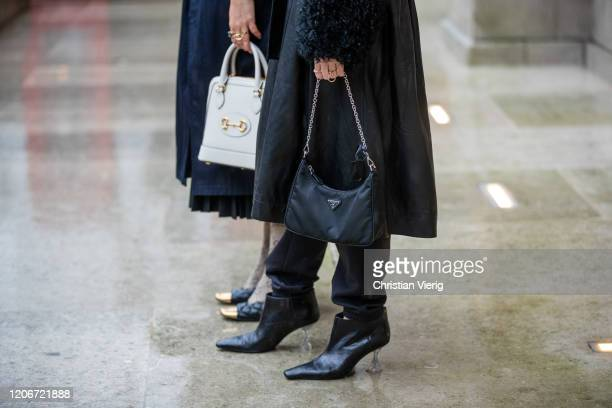 Janka Polliani is seen wearing navy trench coat, Gucci tights, bag and Annabel Rosendahl is seen wearing black belted coat outside Emilia Wickstead...